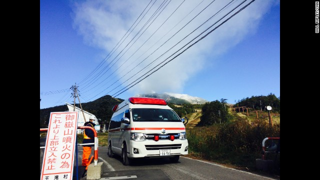 "JAPAN: ""Ambulances bring bodies off Mt. Ontake as small eruptions continue. 31 hikers presumed dead."" - CNN's Will Ripley, September 29. The volcano in central Japan unleashed a huge cloud of ash late Saturday morning that billowed down the mountainside and engulfed hikers in its path. Witnesses described hearing a sound like thunder when the eruption began. FULL STORY AT CNN.COM. Follow Will (@willripleycnn) and other CNNers along on Instagram at instagram.com/cnn."