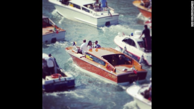 "VENICE, ITALY: First glimpse of the newlyweds George and Amal as they leave their hotel. George Clooney, long considered Hollywood's most eligible bachelor, married British human rights attorney Amal Alamuddin Saturday in a private ceremony in Venice, Italy, his publicist, Stan Rosenfield, told CNN. Clooney arrived by motorboat at a star-studded bash at the Aman Canal Grande Venice resort, housed in the 16th-century Palazzo Papadopoli. ""George, auguri!"" Venetians could be heard offering their best wishes as Clooney waved. ""Auguri!"" Celebrities, paparazzi and the world's media have been congregating in Venice for the widely anticipated nuptials. Photo by CNN's Erin McLaughlin, September 28. Follow Erin (@erincnn) and other CNNers along on Instagram at instagram.com/cnn."