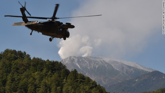 A military helicopter leaves a temporary landing site for a rescue mission on Monday, September 29. Witnesses described hearing a sound like thunder as the volcano began to erupt two days earlier.