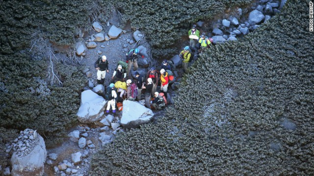 Climbers descend Mount Ontake on September 28.