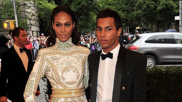 Rousteing is also known for casting diverse models for his catwalk shows and advertising campaigns, and he is pictured here with supermodel Joan Smalls, a regular fixture on the Balmain runway.