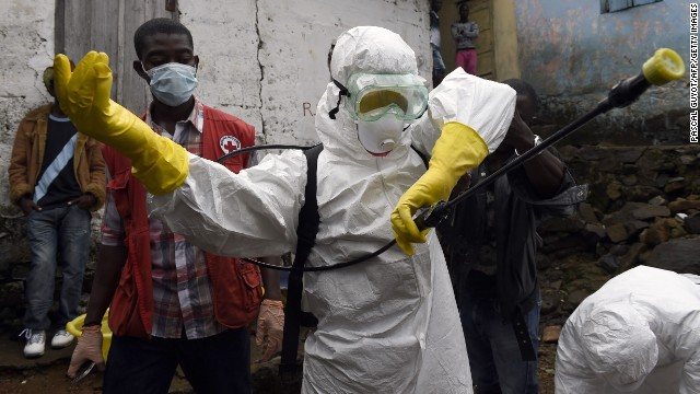 Medics put on protective suits before collecting the corpse of an Ebola victim Monday, September 29, in Monrovia, Liberia. Health officials say the Ebola outbreak in West Africa is the deadliest ever. More than 3,000 people have died, according to the World Health Organization.
