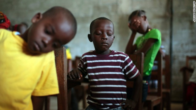 Children pray during Sunday service at the Bridgeway Baptist Church in Monrovia on Sunday, September 28.