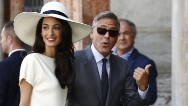 George Clooney, the man long considered one of Hollywood's most eligible bachelors, followed up his private wedding to British human rights attorney Amal Alamuddin with a civil ceremony in Venice, Italy, on Monday.