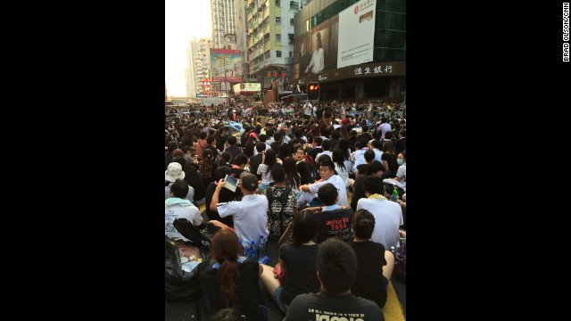"HONG KONG: ""Occupy Mongkok. The intersection of Nathan Road and Argyle Street. Thousands have gathered and are staging a peaceful sitin in support of the students. They come from all walks of life. There are no police in sight. The crowd keeps on growing."" - CNN's Brad Olson, September 29. Hong Kong is being gripped by pro-democracy protests. Demonstrators are angry at China's decision to allow only Beijing-vetted candidates to stand in the city's elections for chief executive in 2017. Follow Brad (@cnnbrad) and other CNNers along on Instagram at instagram.com/cnn."