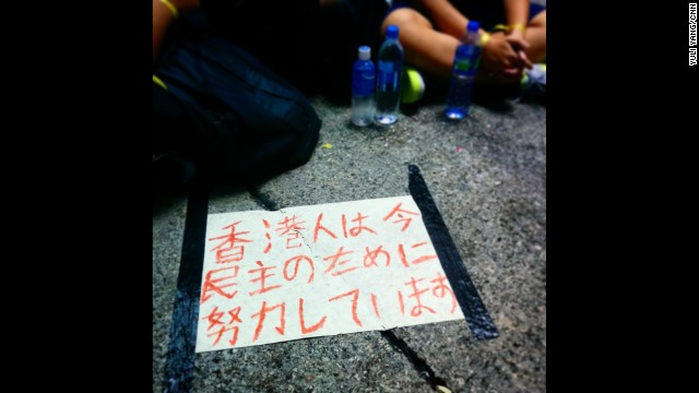 "HONG KONG: In Japanese it reads, ""the Hong Kong people are now efforting for democracy."" - CNN's Yuli Yang, September 29. Hong Kong is being gripped by pro-democracy protests. Demonstrators are angry at China's decision to allow only Beijing-vetted candidates to stand in the city's elections for chief executive in 2017. Follow Yuli (@macchax) and other CNNers along on Instagram at instagram.com/cnn."