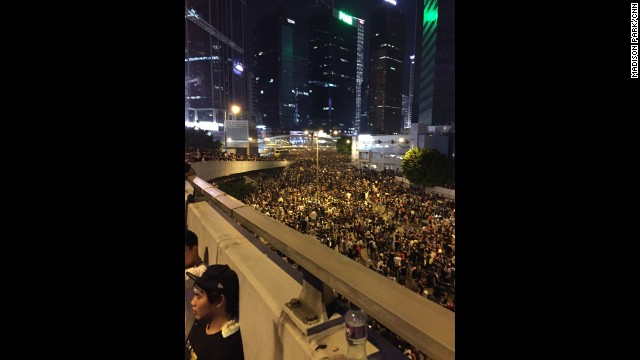 HONG KONG: Protesters rest on the side of a ramp above an occupied highway in central Hong Kong. Thousands of pro-democracy protesters remained camped out on major highways in the heart of Hong Kong on Monday, defying government attempts to both coerce and cajole them into giving up their extraordinary demonstration. Photo by CNN's Madison Park, September 29. Follow Madison (@yippeyay2) and other CNNers along on Instagram at instagram.com/cnn.