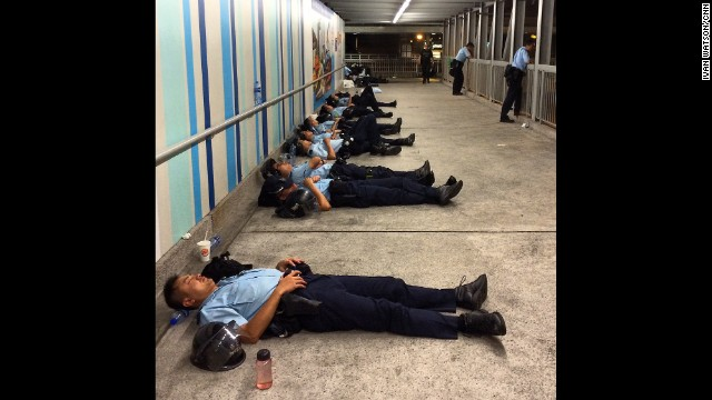 "HONG KONG: ""Police officers napping during what has been a long night of unrest in Hong Kong. Authorities say dozens of demonstrators and at least 6 police were wounded in clashes on Sunday."" - CNN's Ivan Watson, September 28. Hong Kong is being gripped by pro-democracy protests. Demonstrators are angry at China's decision to allow only Beijing-vetted candidates to stand in the city's elections for chief executive in 2017. Follow Ivan (@ivancnn) and other CNNers along on Instagram at instagram.com/cnn."