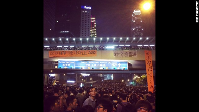 "HONG KONG: ""Do you hear the people sing"" Broadway-inspired slogan in front of a sea of young demonstrators occupying downtown Hong Kong. Another sign takes a line from song by the band Beyond which has become an anthem here: ""we're trying to hold on to our freedom amid the storm"" (rough translation). Thousands of pro-democracy protesters remained camped out on major highways in the heart of Hong Kong on Monday, defying government attempts to both coerce and cajole them into giving up their extraordinary demonstration. Photo by CNN's Ivan Watson, September 29. WATCH THE INSTAGRAM VIDEO from Ivan as demonstrators chant ""resign"" to City's leader, and ""add oil"" (more support) to each other. Follow Ivan (@ivancnn) and other CNNers along on Instagram at instagram.com/cnn."