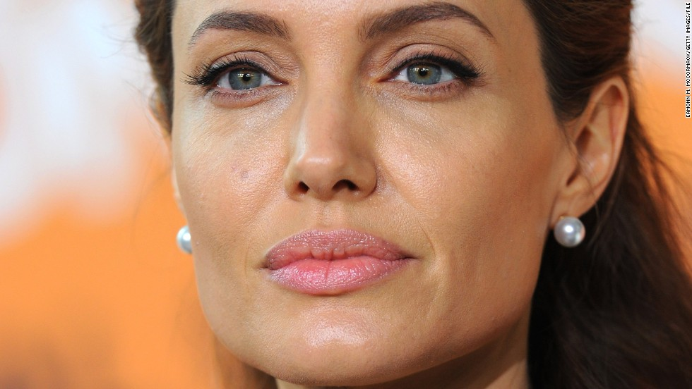 "Angelina Jolie didn't just make a fan happy; she helped comfort her. <a href='http://www.nydailynews.com/entertainment/gossip/angelina-jolie-comforts-crying-fan-daily-show-article-1.2034576' target='_blank'>According to the New York Daily News</a>, Jolie was leaving the ""Daily Show"" studios on Thursday, December 4, when a waiting fan named Techne exclaimed that she was having a panic attack. Jolie took time to wipe her tears, signed some memorabilia and took two selfies with her. She's not the only celebrity to join the rest of us in real life."