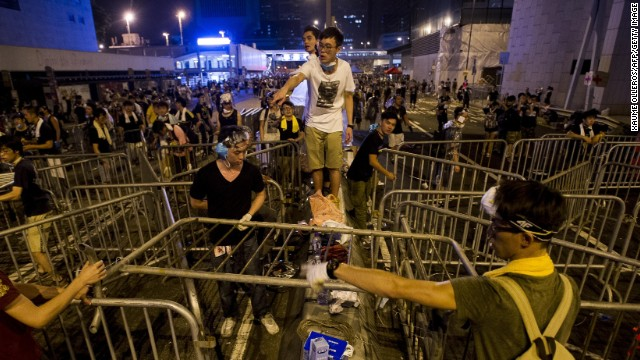 Students erect barricades in the main protest area adjacent to the Hong Kong government buildings.