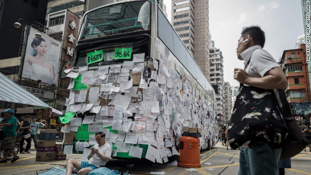 "Numbers are used as political shorthand by the protesters. ""689"" stands for Hong Kong chief executive CY Leung, referring to the number of votes he received to win office. This bus is emblazoned with messages to Leung -- its route number has been changed to ""689,"" its destination reads ""Hell."""