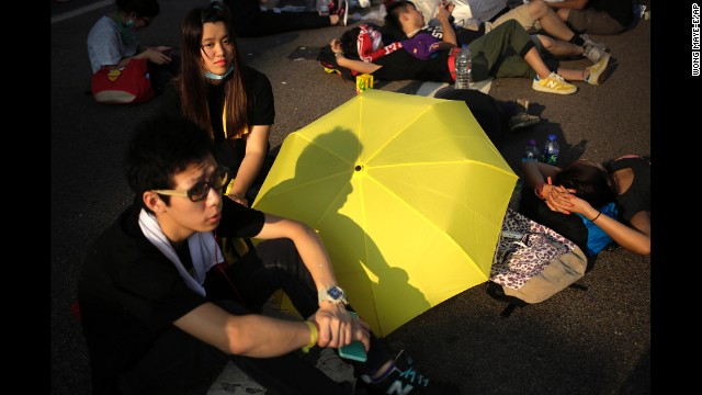 Student activists rest on a road in Hong Kong on September 30, near the government headquarters where pro-democracy activists have gathered.
