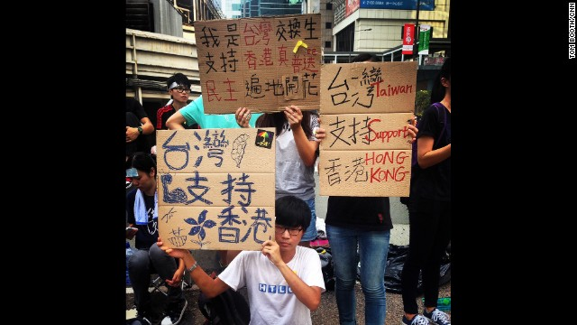 "HONG KONG: ""Young Taiwanese exchange students based in Hong Kong showing their support for the people of Hong Kong."" - CNN's Tom Booth, September 30. Thousands of protesters clamoring for full democracy in Hong Kong stood their ground Tuesday even as the head of its government said China won't give in to their demands. Protesters camped out with masks, protective goggles and plastic raincoats on the main road leading into the city's central business district -- bracing for a potential encore to the fierce police crackdown that engulfed the crowd in tear gas two days earlier. FULL STORY AT CNN.COM. Follow Tom (@tboothhk) and other CNNers along on Instagram at instagram.com/cnn."