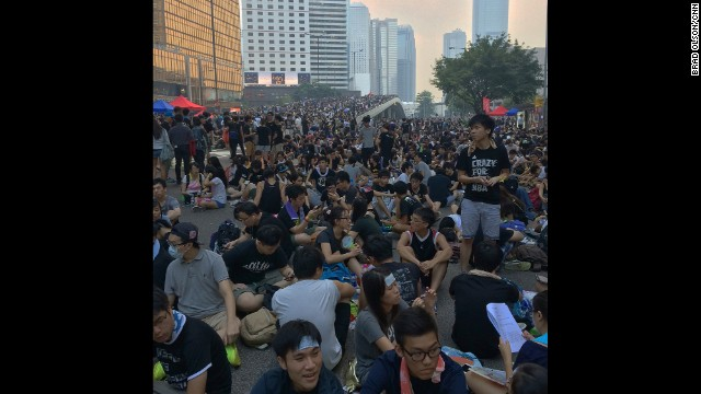 "HONG KONG: ""Night is falling and tens of thousands have assembled at the Central Government Offices in Hong Kong. This morning there were not so many people about but tomorrow is a public holiday and it looks like the demonstrations will be huge. It's all peaceful. The riot police are nowhere to be seen and the police who are present are helping keep things organized. There is no animosity, no violence , no crime and the crowd is in good spirits. I wonder what they are thinking in Beijing?"" - CNN's Brad Olson, September 30. Follow Brad (@cnnbrad) and other CNNers along on Instagram at instagram.com/cnn."