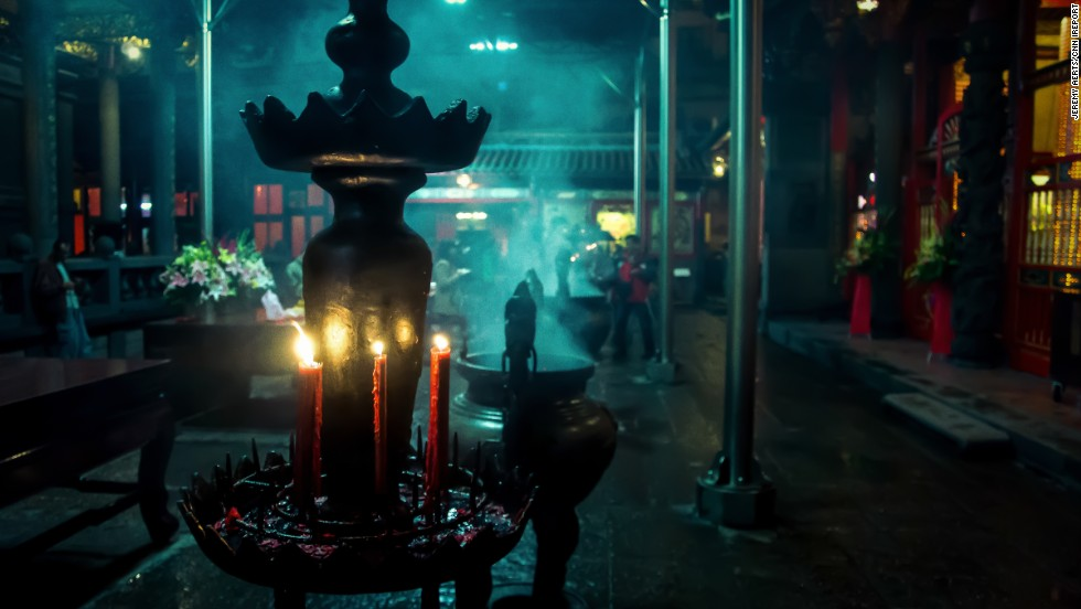 """Incense and candles set the mood at <a href='http://ireport.cnn.com/docs/DOC-1152367'>Longshan Temple</a> in Taipei, Taiwan. Walking through the temple """"felt as if I traveled back hundreds of years to a time long forgotten,"""" said Jeremy Aerts."""