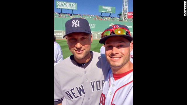 Boston Red Sox pitcher Joe Kelly, right, snaps a selfie with retiring New York Yankees captain Derek Jeter before Jeter played the final game of his career Sunday, September 28, in Boston. Kelly <a href='https://twitter.com/JosephKellyJr/status/516382468854013952' target='_blank'>tweeted the photo</a> with the hashtags #RE2PECT and #2ELFIE in honor of Jeter's jersey number. <a href='http://www.cnn.com/2014/09/22/worldsport/gallery/derek-jeter/index.html'>See photos from Jeter's 20-year career</a>