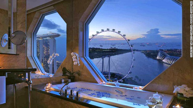 Marble bathrooms in the Ritz-Carlton, Millenia Singapore's bay view rooms overlook the iconic Marina Bay Sands, Singapore Flyer and city skyline.