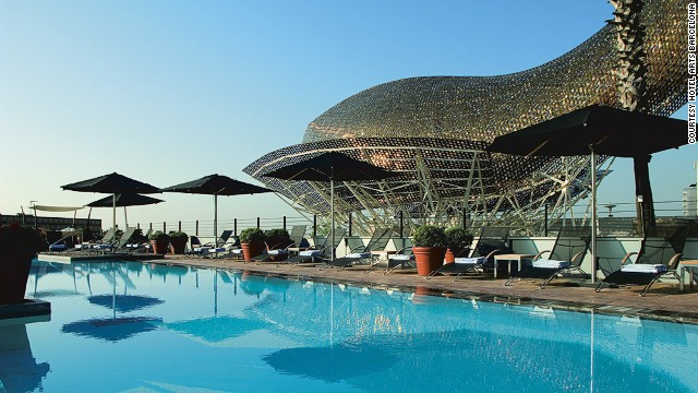 Hotel Arts Barcelona is easily identifiable thanks to its Frank Gehry-designed golden steel fish statue, which overlooks the pool.