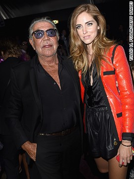 The blogger, pictured here with Roberto Cavalli, was a student at Bocconi University in Milan when she started taking photos of her outfits and sharing them online. Now she collaborates with luxury brands on advertising campaigns, and has her own shoe line.