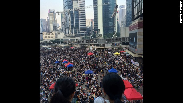 "HONG KONG: ""People looking out at the crowd of pro-democracy protesters in Admiralty, Hong Kong, which swelled over the course of Tuesday afternoon and evening ahead of tomorrow's public holiday."" - CNN's Jethro Mullen, September 30. Follow Jethro (@jethromullen) and other CNNers along on Instagram at instagram.com/cnn."