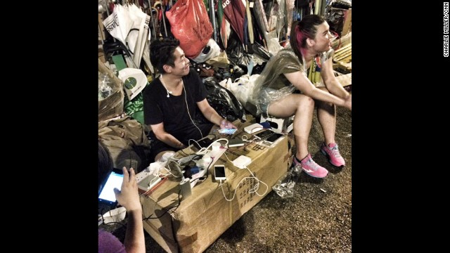 "HONG KONG: ""Pro-democracy protestors charge phones at a makeshift street charging point in Hong Kong's Admiralty district."" - CNN's Charlie Miller, September 30. Thousands of protesters clamoring for full democracy in Hong Kong stood their ground Tuesday even as the head of its government said China won't give in to their demands. Protesters camped out with masks, protective goggles and plastic raincoats on the main road leading into the city's central business district -- bracing for a potential encore to the fierce police crackdown that engulfed the crowd in tear gas two days earlier. Follow Charlie (<a href='http://instagram.com/cnncharlie' target='_blank'>@cnncharlie</a>) and other CNNers along on Instagram at <a href='http://instagram.com/cnn' target='_blank'>instagram.com/cnn</a>."