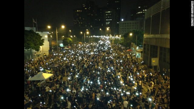 "HONG KONG: ""It is now October 1, China's National Day -- the day to celebrate the founding of the P.R.C. And this is the scene in Hong Kong. That's the glowing screens of mobile phones held aloft in the sea of protesters."" - CNN's Kristie Lu Stout. Follow Kristie (@klustout) and other CNNers along on Instagram at instagram.com/cnn."