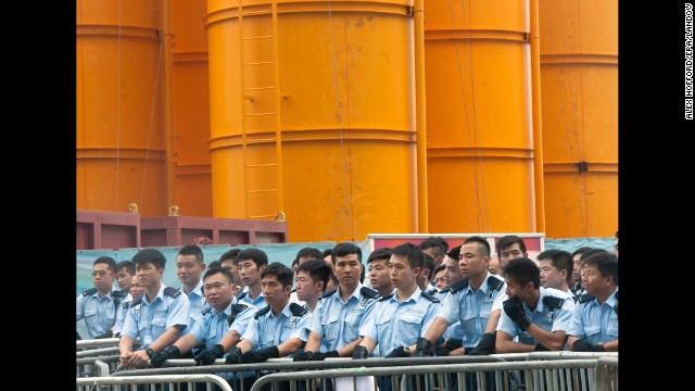 Hong Kong police stand guard outside the flag-raising ceremony October 1.