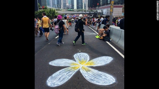 "HONG KONG: ""A chalk drawing of a bauhinia, the emblem of Hong Kong, blooms on a multi-lane highway leading into the main site of pro-democracy protests near government headquarters."" - CNN's Jethro Mullen, October 1. Follow Jethro (@jethromullen) and other CNNers along on Instagram at instagram.com/cnn."