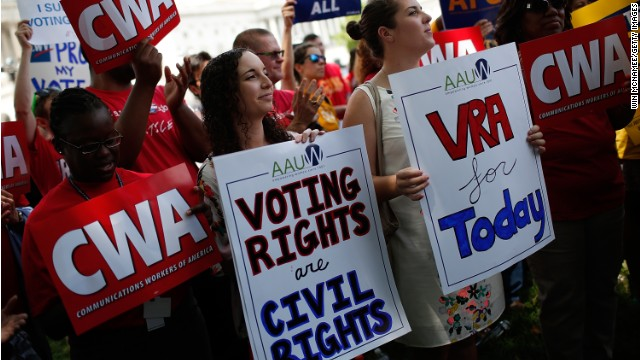 Activists in Washington mark the one-year anniversary of the Supreme Court decision to alter the Voting Rights Act.