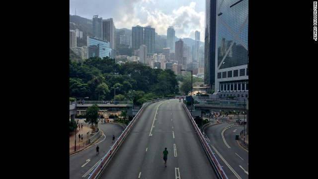 "HONG KONG: ""One of the many highways in Hong Kong that are usually packed with traffic but are now given over to pedestrians because of the big pro-democracy protests that have spread through the center of the city."" - CNN's Jethro Mullen, October 1. Follow Jethro (@jethromullen) and other CNNers along on Instagram at instagram.com/cnn."