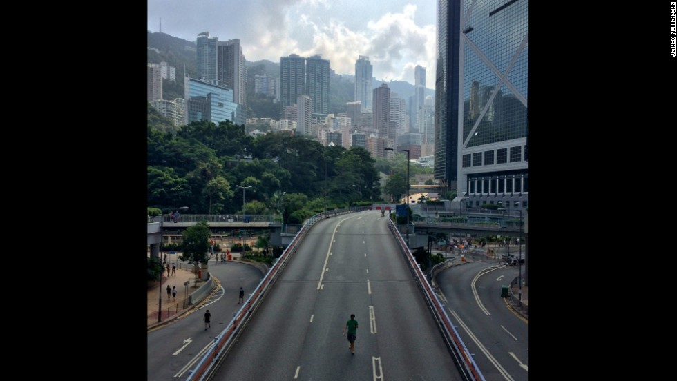 """HONG KONG: """"One of the many highways in Hong Kong that are usually packed with traffic but are now given over to pedestrians because of the big pro-democracy protests that have spread through the center of the city."""" - CNN's Jethro Mullen, October 1. Follow Jethro (<a href='http://instagram.com/jethromullen' target='_blank'>@jethromullen</a>) and other CNNers along on Instagram at <a href='http://instagram.com/cnn' target='_blank'>instagram.com/cnn</a>."""