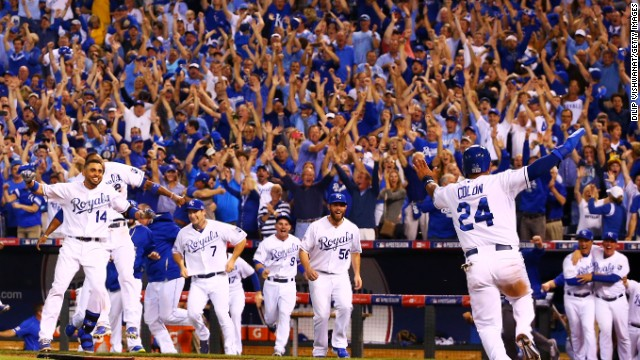 The Kansas City Royals celebrate their win over Oakland in the 12th inning of their American League Wild Card game.