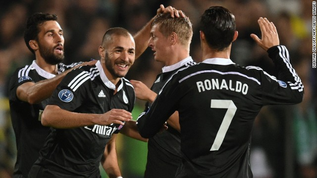 Benzema is congratulated on his winner as Real breathed a sigh of relief to come away with all three points.
