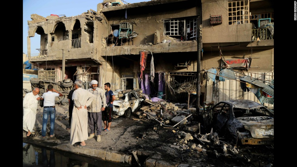 People inspect the site of a double car bombing in Baghdad on Wednesday, October 1. The United Nations said Wednesday that at least 1,119 Iraqis were killed in September in acts of terrorism and violence.