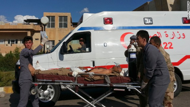 A Kurdish Peshmerga soldier who was wounded in battle is wheeled to the Zakho Emergency Hospital in Dahuk, Iraq, on Tuesday, September 30.