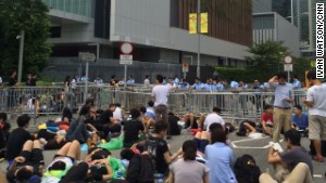 Protesters to C.Y. Leung: Resign