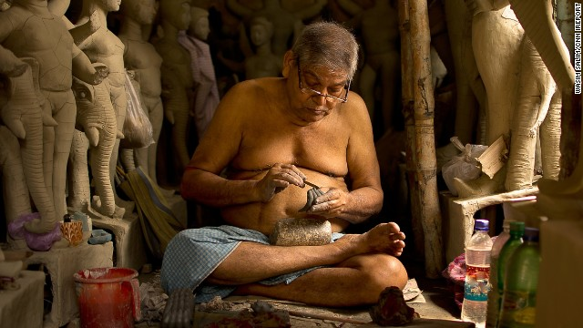 An artisan creates <a href='http://ireport.cnn.com/docs/DOC-1027924'>traditional statues</a> of Hindu gods and goddesses in Kolkata, India. One idol takes 10 to 15 days to be completed.