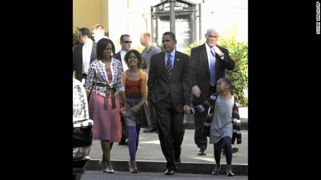 In this Oct. 11, 2009 file photo, Secret Service Agent Joseph Clancy, right, walks behind President Barack Obama, first lady Michelle Obama and their, children Sasha, right, and Malia, second from left, walk back to the White House after attending St. John's Episcopal Church in Washington. Secret Service Director Julia Pierson resigned Wednesday, a day after bitingly critical questioning by Congress about a White House security breach. There had been increasing calls for her departure during the day. Pierson will be replaced by Clancy, a former special agent in charge of the president's protective detail who retired in 2011.