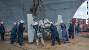 A team of shipbuilders replaces USS Abraham Lincoln\'s anchor with one removed from the USS Enterprise.
