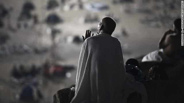 OCTOBER 3 - MOUNT ARAFAT, SAUDI ARABIA: A Muslim pilgrim prays as he takes part in a Hajj ritual near Mecca. <a href='http://cnn.com/2013/06/21/world/hajj-fast-facts/'>More than two million Muslims</a> take part in the annual pilgrimage and performing Hajj is considered one of the five pillars of Islam.
