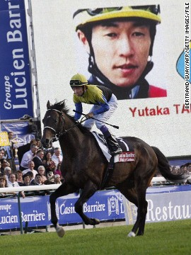 """Both Deep Impact and jockey Yutaka Take are legends of Japanese horse racing. The stallion raced to third in the 2006 Arc before later being disqualified for testing positive for a banned substance used to treat respiratory problems. Take is credited with helping popularize horse racing during the 1980s and is a superstar in Japan. He has also blazed a trail for his younger counterparts. """"Handsome young jockeys are kind of like rock stars and ladies come to the racetrack not for the racing but to see their favorite jockey,"""" says Naohiro Goda, a leading Japanese racing pundit."""