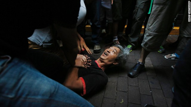 Pro-democracy student protesters pin a man to the ground after an assault during a scuffle with local residents in Mong Kok, Hong Kong on October 4. Friction persisted between pro-democracy protesters and opponents of their weeklong occupation of major Hong Kong streets, and police denied they had any connection to criminal gangs suspected of inciting attacks on largely peaceful demonstrators.