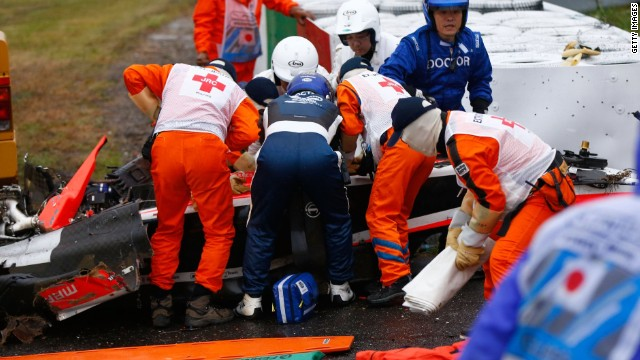 The Marussia driver receives urgent medical treatment after crashing during the Japanese Grand Prix at Suzuka.