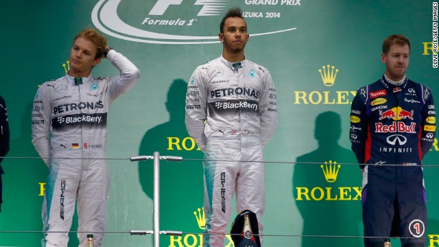 The mood on the victory podium is subdued with Lewis Hamilton taking the win from teammate Nico Rosberg with Sebastian Vettel in third.