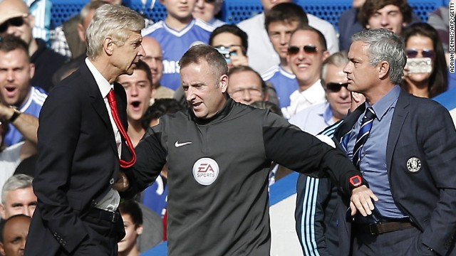 Arsene Wenger and Jose Mourinho have to be separated by fourth official Jonathon Moss in the EPL clash at Stamford Bridge.