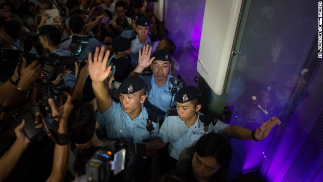 Pro-democracy demonstrators surround police October 5 in the Mong Kok district of Hong Kong.