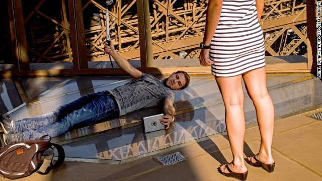 Visitors are lining up -- and lying down -- to experience the Eiffel Tower's new glass floor.