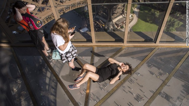 The glass floor looks down on the 57-meter drop to the ground beneath.