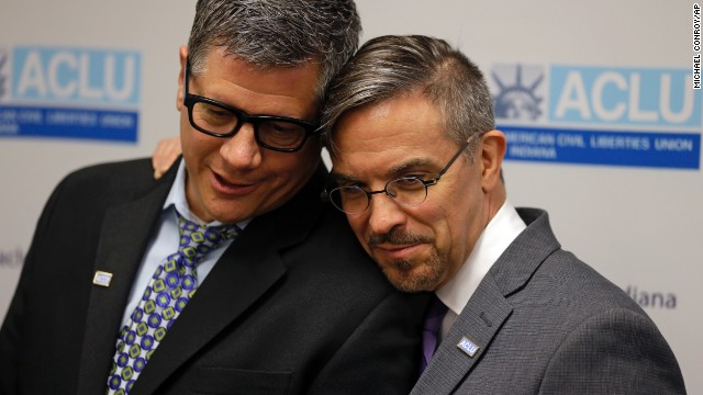 Rob MacPherson, right, and his husband, Steven Stolen, hug during a news conference at the American Civil Liberties Union in Indianapolis on October 6.